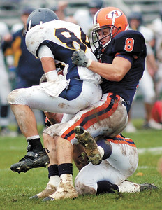 jhhobartroch2 - Hobart defensive back Mike Kaplun, (8)  a graduate of Webster Schrader and teammate Tyler Mason combine to tackle Zach Ingoldsby after his reception for the University of Rochester druing the host Statesmen's 31-21 win over the Yellowjackets on Saturday.