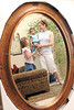 jhisabella1 - Kelsey Bright holds Isabella while sister Anna looks on in a reflected mirror inside their Victor home.