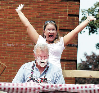 jhsulphur1 - Renee Archer celebrates as she and partner Ovid Randall win their heat of the Pie Heating Contest at Sulphur Springs Festival on Saturday, June 2.