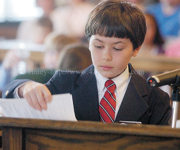 jhmocktrial4 - Jeremy Trevvett from Canandaigua checks over papers while questioning a witness during the mock trial.