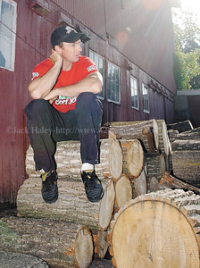 jhwoodsman3 - Dave Jewett sits on a wood pile at the farm he trains at after an early morning workout.