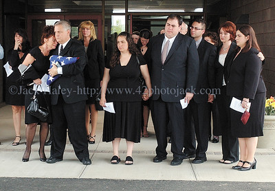 jhfuneral1 - Family and firends of Steve Butcher, Jr, watch as his casket is placed inside the hearst after  his services at New Covenant Christian Fellowship on Saturday, June 2.