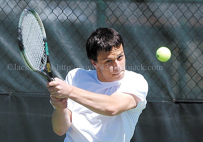 jhtennis1 - Zbynek Zajic of Pal-Mac returns a backhand during his singles match with Chris Tanea of Newark on Wednesday during the sectional qualifier.