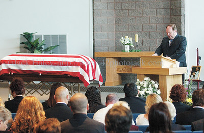 jhfuneral6 - Rev. Philip McNeill gives the Benediction during funeral services for Staff Sgt. Steve Butcher, Jr.