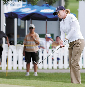 jhlpga3 - Cristie Kerr pitches  her way on to the green at the 18th hole as she posted a 6-under-par 66 to take  the first  round lead in the LPGA Wegman's Rochester Internatiional.