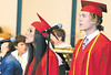 jhCAgraduation1 - Taylor DeLeo and Isac Tayrien sing the National Anthem to lead off the 119th Commenencemtn Exercises for the Canandaigua Academy Class of 2007 at the CPAC on Saturday (6-23).
