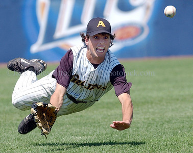 jhathena1 - Greece Athena left fielder  Andrew Dipasquale dives,  but comes up short, on a ball hit to  left in the seventh inning during the Trojans semifinal loss to North Rockland on Saturday in Binghamton.