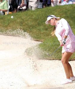 jhlpga1 - Paula Creamer hits out of the sand at the 18th hole. The popular golfer is tied for seventh at two under  par.