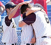 jhathena3 - (L-R) Greece Athena's Sean Meritt, David Russell, and Brian Dupra hug after the Trojans fell 2-1 to the Raiders of North Rockland in the Class AA semifinal on Saturday in Binghamton.