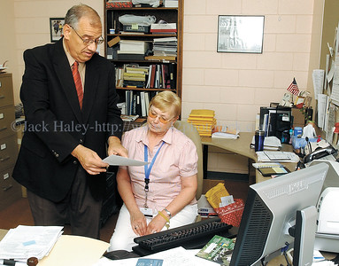 jhsheriff1 - Ontario County Sheriff Phil Povero goes over some paper work with receptionist Donna Parmele on Tuesday, June 19. The Sheriff returned to work on June 1 after have major heart surgery.