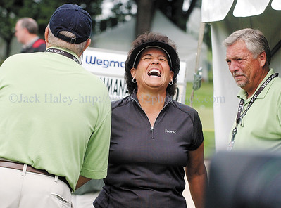 jhlopez4  - Nancy Lopez shares a laugh with two volunteers before  she started play at the Wegman International on Thursday, 6-21.