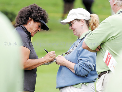 jhlopez3 - A fan gets an autograph from Nancy Lopez before she started off at  the Wegman International.