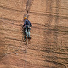 A climber checks on a partner below. Zion National Park. Taken from the road the leads to the Narrows Canyon.