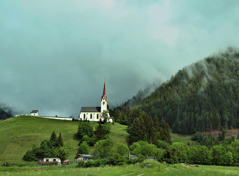 Chapel near Lienz, Austria, May 28, 2011. Taken form the bus thru the window at speed.
