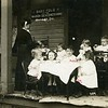 Children eating at the Baby Fold (orphanage) of the Mason Deaconess Home, Normall, Illinois, ca. 1905.  RPPC