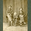Two men and a child with a gun, ca. 1890.  Ptgr:  Baumgardner, Lake Odessa, MI. MP AP