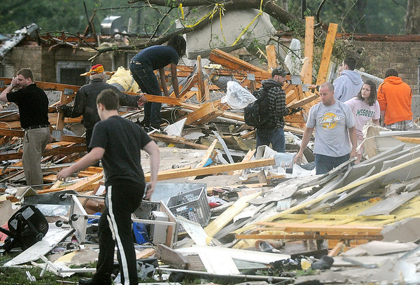 Globe/Roger Nomer<br /> Rescuers look through a damaged building near 15th and Range Line on Sunday evening.