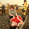 Globe/B.W.Shepherd<br /> A man trys to comfort a women pulled out from the wreckage of Dillons Grocery Store by the Carthage Fire Department an hour after the EF-5 tornado Hit Joplin on Sunday evening, May 22, 2011.