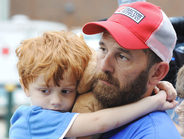 Globe/T. Rob Brown<br /> Four-year-old Griffan Keller clutches onto a Teddy bear and his father, Travis Keller, while listening to Joplin (Mo.) City Manager Mark Rohr during a Q & A Friday evening, May 27, 2011, outside the American Red Cross shelter at Missouri Southern State University's Leggett & Platt Athletic Center. The Kellers lost their home, formerly located at 2601 S. Virginia Ave., during Sunday's tornado, May 22, 2011.