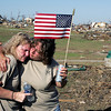 Paula Barnett, left, and Susan Dodson, both of Joplin, comfort each other during a moment of silence ceremony at Cunningham Park in Joplin, Mo.  The ceremony marked a week since the May 22 tornado struck the Joplin area, including Cunningham Park.