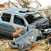 Globe/T. Rob Brown<br /> A mangled car gives witness to the scene Wednesday morning, May 25, 2011, just off Range Line Road in the thickest part of the devastation.