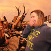 Globe/B.W.Shepherd<br /> A women in tears near 20th and Connecticut lookes through a damaged home searching for loved ones 2 1/2 hours after the EF-5 tornado hit Joplin on May 22, 2011. A beautiful oarge sunset illuminated the evening sky.