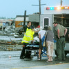 Globe/Roger Nomer<br /> Emergency workers load a patient into a waiting ambulance following Sunday's tornado.