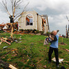 Globe/Mike Gullett<br /> Paul Cheatam carries Ian Ward to get help after a tornado struck Joplin, Mo, on Sunday, May 22, 2011.