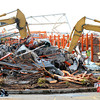 Globe/B.W.Shepherd<br /> Three large Caterpillar loaders dig into the pile of rubble early Tuesday morning at Home Depot on May 24, 2011.