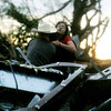 Globe/Roger Nomer<br /> A woman clings to the back of her rescuer from a destroyed building at 17th and Range Line Road in the immediate aftermath of the May 22, 2011, tornado in Joplin, Mo.