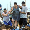 Globe/B.W.Shepherd<br /> A women is helped out of the rubble of a destroyed home 30 minutes after an EF-5 tornado destroyed  Joplin on Sunday evening, May 22, 2011. Many ordinary citizens dug out and rescued others in need.