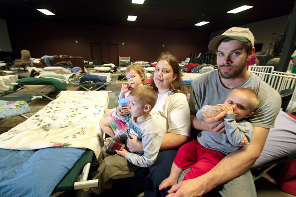Globe/Curtis Almeter<br /> Robert and Mimi Pfeiffer with children Zacharia age 1, Kathryn age 3 and Christian age 4 stay at Ignite.tv church in Joplin after losing their home from the twister.