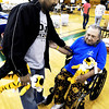 Globe/T. Rob Brown<br /> New MU head basketball coach Frank Haith shows some support for John Ness, of Joplin, whose Pennsylvania Street home was destroyed Sunday, during a visit to the Missouri Southern State University shelter in the Leggett & Platt Athletic Center. Haith and assistants brought in stuffed tigers to give to children and others in need of comfort. Ness said he was in the wheelchair due to injuries sustained during the tornado.