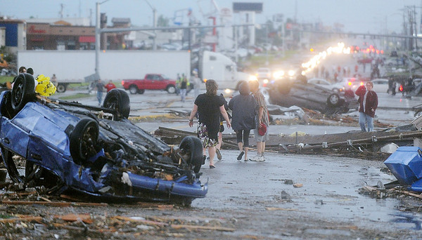 Globe/Roger Nomer<br /> The path of the tornado is shown along Range Line Road on Sunday evening.