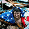 An unidentifed man emerges from his destoyed home  in Joplin, Mo., about 15 minutes after the EF-5 tornado hit on Sunday evening, May 22, 2011.