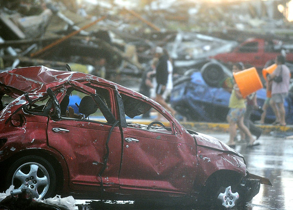 Globe/Roger Nomer<br /> A damaged car rests in the parking lot of Academy Sports on Sunday evening.