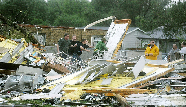 Globe/Roger Nomer<br /> Rescuers look for survivors in the Payless Shoestore on Range Line Road on Sunday evening.