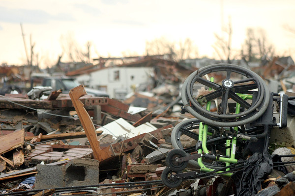 Globe/Curtis Almeter<br /> A wheel chair stands out in the rubble of a demolished nursing home.