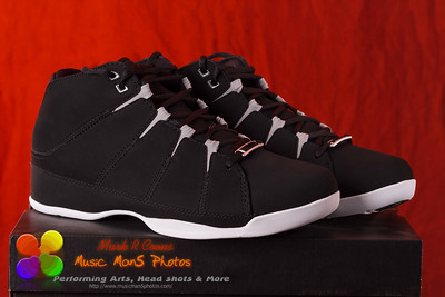Black high top  basketball shoes perched on the box