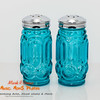 blue glass and silver topped salt and pepper shakers