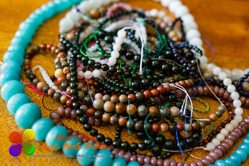 pile of bead strands waiting to be made into jewelry