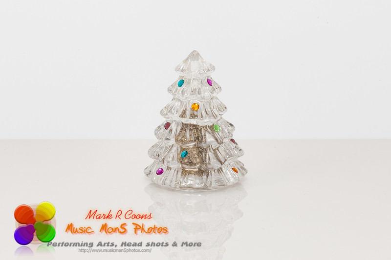 decorated holiday crystal tree filled with sand