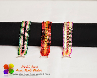 a group of three hand stitched flat beaded bracelets