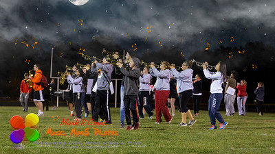 marching and playing under the night sky