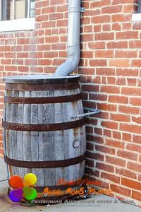 an old rain barrel in an urban setting