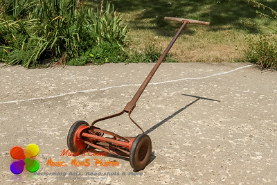 full view of a reel lawnmower before the paint was removed