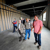Developer Jim Whitney (right) gives a tour of City Place with Leominster residents Louis Charpentier, who worked in the building when it was formerly Commonwealth Plastics, and his son Ernie Charpentier, Wednesday.<br /> SENTINEL & ENTERPRISE / BRETT CRAWFORD