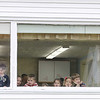 Student at the new Child Development Center at the Applewild School in Fitchburg look out the window as people gathered for the ribbon cutting ceremony of the new center. SENTINEL & ENTERPRISE/ JOHN LOVE