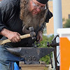 Blacksmith Ted Hinman works on a piece during the Blacksmith Art & Music Festival formerly known as the Fitchburg Forge during it's 10th anniversary on Saturday in Fitchburg. SENTINEL & ENTERPRISE/ JOHN LOVE