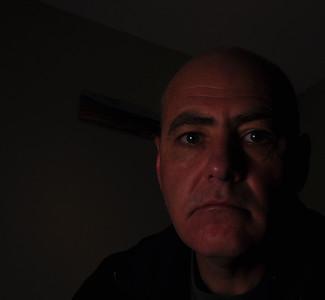 12/13/09  Self Portrait, I'm starting to play around with off camera lighting.